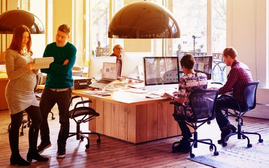 people working in an open indoor office space